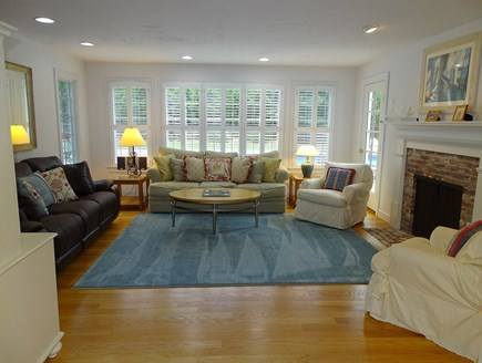 Brewster Cape Cod vacation rental - A second family room with two couches, door to back pool area