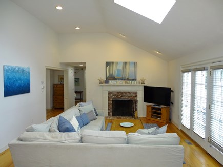 Brewster Cape Cod vacation rental - Living area with flat screen TV, skylights, door to deck and pool