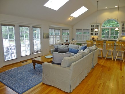 Brewster Cape Cod vacation rental - Open living area, leads to kitchen and kitchen dining table