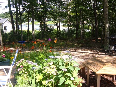East Falmouth Cape Cod vacation rental - Picnic table and gas grill for outdoor dining.