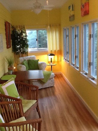 East Falmouth Cape Cod vacation rental - Bright sunroom facing back deck and water.