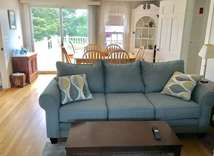 Chatham Cape Cod vacation rental - Living room with dining room and slider to deck in back.