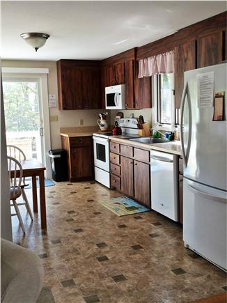 Eastham Cape Cod vacation rental - Eat-in Kitchen with Slider to Deck