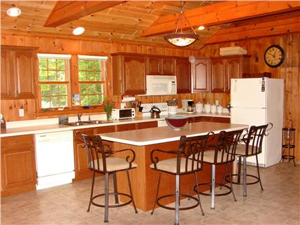 South Dennis Cape Cod vacation rental - Spacious kitchen area with casual bar serving area.