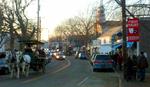 Horse drawn carriage rides through town