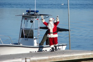 Santa arrives by boat during Christmas in Orleans, Cape Cod