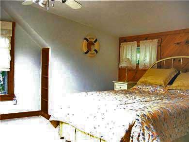 Oak Bluffs Martha's Vineyard vacation rental - 1 of 3 bedrooms;queen brass bed, ceiling fan in sun-lit  loft