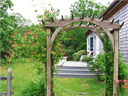 West Tisbury Martha's Vineyard vacation rental - The arbor takes you to the front deck, herb garden and flowerbeds