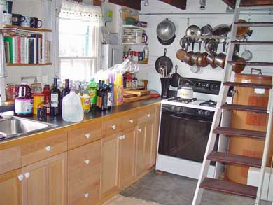 Oak Bluffs Martha's Vineyard vacation rental - Kitchen with stairs that lead to a waterside double bedded room