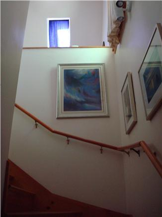 Vineyard Haven Martha's Vineyard vacation rental - Entry hall and stairway with art and photographs on display