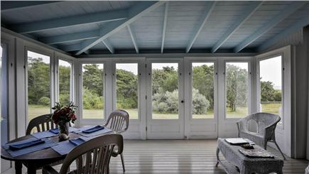 Chappaquiddick, Edgartown Martha's Vineyard vacation rental - Screened porch with water views opens to kitchen/dining room