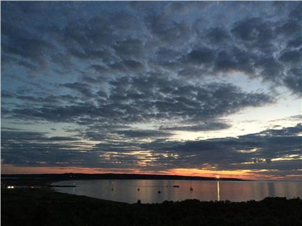Chilmark, Menemsha Martha's Vineyard vacation rental - Sunset from deck in Aug. GayHead Lighthouse&green jetty light.