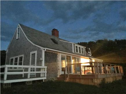 Chilmark, Menemsha Martha's Vineyard vacation rental - The house and two decks at night, looking up the hill at night.