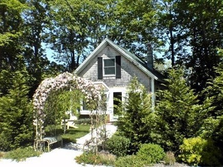 Vineyard Haven, Tisbury Martha's Vineyard vacation rental - Cottage Front w/Arbor set far back from the one way road