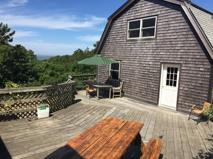 Chappaquiddick, Edgartown Martha's Vineyard vacation rental - Outdoor deck between the main house and back building.