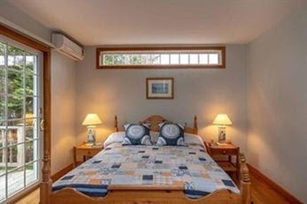 Edgartown Martha's Vineyard vacation rental - Downstairs bdrm w/ queen bed & door to full bath & private deck.