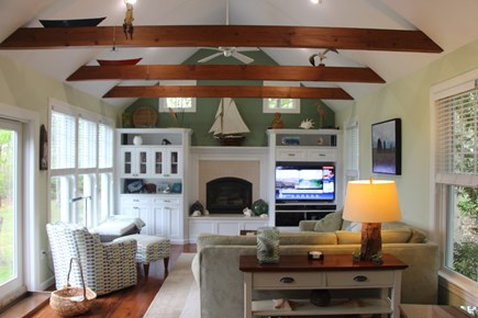 Edgartown Martha's Vineyard vacation rental - The Great Room has full water views, fireplace, a curved Smart TV