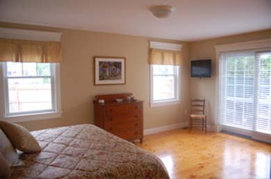 Edgartown Martha's Vineyard vacation rental - 1st Floor bedroom with king bed glass doors to open deck