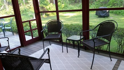 Edgartown Martha's Vineyard vacation rental - Sitting area of screened porch and adjacent open deck