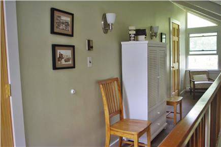 Edgartown Martha's Vineyard vacation rental - Upstairs hall w/ extra dining chairs, blankets, books & puzzles