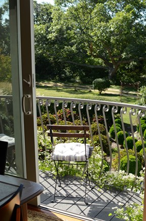 Chilmark - off Meetinghouse Rd Martha's Vineyard vacation rental - Balcony overlooks patio and giant oaks beyond