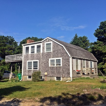 Chappaquiddick Martha's Vineyard vacation rental - Side view of the house and deck w/views of pond & barrier beach