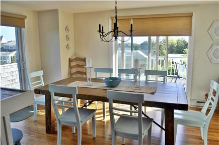 Katama - Edgartown, katama Martha's Vineyard vacation rental - Dining area with two sets of sliders to outdoor seating/BBQ