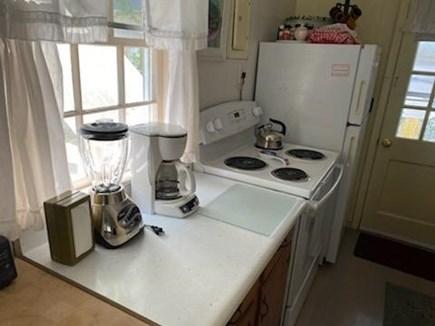 Oak Bluffs Martha's Vineyard vacation rental - Galley kitchen showing range and refrigerator