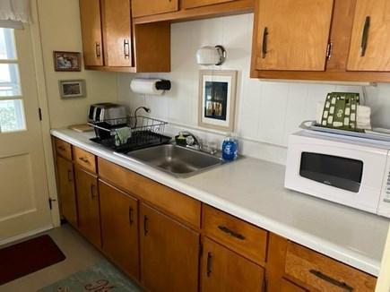 Oak Bluffs Martha's Vineyard vacation rental - Galley kitchen showing sink and microwave