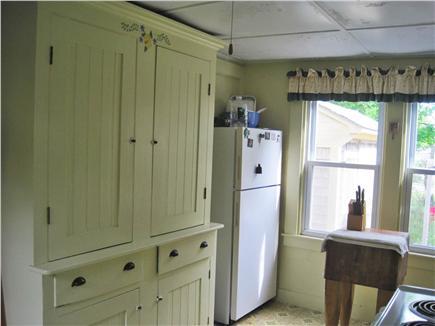 Oak Bluffs Martha's Vineyard vacation rental - Kitchen with new refrigerator & antique cupboard