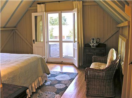 Oak Bluffs Martha's Vineyard vacation rental - MBR - French doors to private balcony with ocean view.