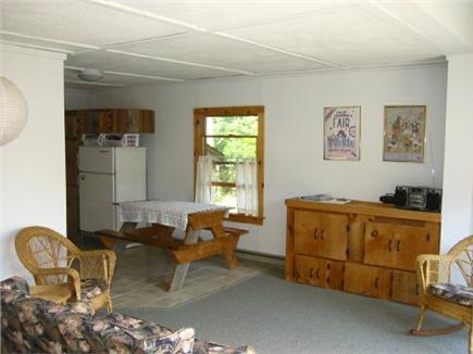 Edgartown Martha's Vineyard vacation rental - Living room with TV in cabinet, opens up to deck