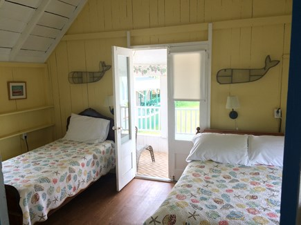 Oak Bluffs, Copeland District Martha's Vineyard vacation rental - Yellow bedroom has twin and full size beds, private balcony, TV.