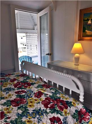 Oak Bluffs, Copeland district. In town by  Martha's Vineyard vacation rental - Bedroom with double bed, sink and balcony overlooking the Sound.