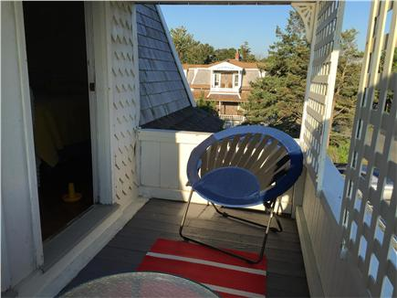 Oak Bluffs, Copeland district. In town by  Martha's Vineyard vacation rental - Balconied bedroom has seating for two and a table on the balcony.