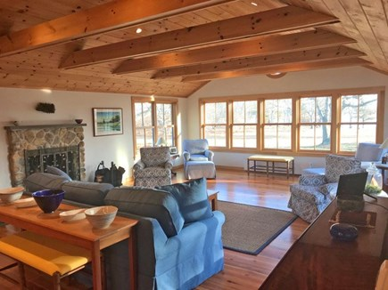 Chilmark Martha's Vineyard vacation rental - LR's local fieldstone FP and full wall of waterview windows.