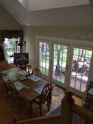 Edgartown Martha's Vineyard vacation rental - View looking from second floor to dinning area and entry to deck.