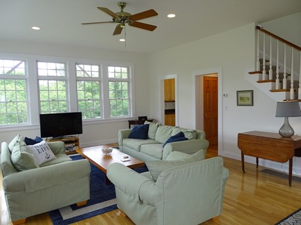 Edgartown Martha's Vineyard vacation rental - View of living room showing wet bar, stairs to master suite