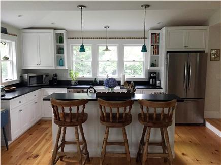 Oak Bluffs Martha's Vineyard vacation rental - Open kitchen and bar with granite counter tops and farmhouse sink