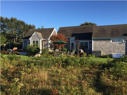 Edgartown Martha's Vineyard vacation rental - Back view of patio and house from fall meadow