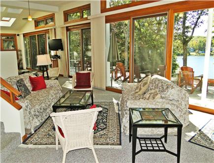 Lambert's Cove  West Tisbury Martha's Vineyard vacation rental - Sunny living room overlooking pond with multiple sliders to deck