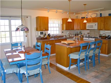 West Tisbury Martha's Vineyard vacation rental - Open kitchen and dining room with glass slider out to the deck