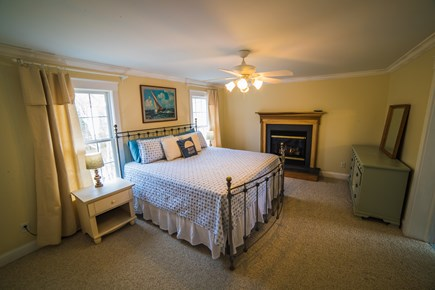 West Tisbury Martha's Vineyard vacation rental - Master bedroom w/2 closets, dresser, fire place and master bath.