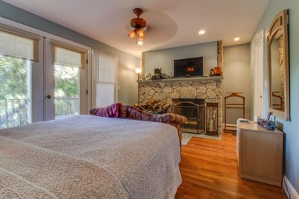 Edgartown Martha's Vineyard vacation rental - The master suite features a queen bed, private deck, & fireplace