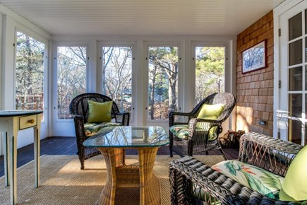 Oak Bluffs Martha's Vineyard vacation rental - A charming enclosed sunroom has wicker furniture & large windows