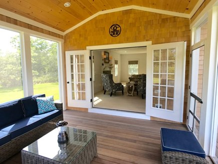 West Tisbury Martha's Vineyard vacation rental - The srcreened porch open to the house and the pation