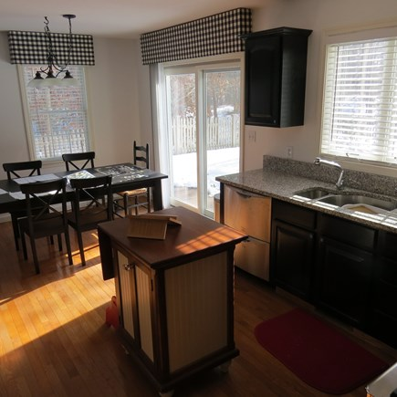 Vineyard Haven, Tisbury Martha's Vineyard vacation rental - Kitchen and dining room with sliders to the deck