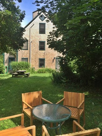 Vineyard Haven Martha's Vineyard vacation rental - Lush green back yard with two tables.