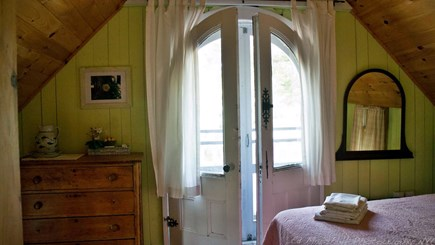 Oak Bluffs (MVCMA) Martha's Vineyard vacation rental - Charming front bedroom, vintage doors to balcony with (1)Queen