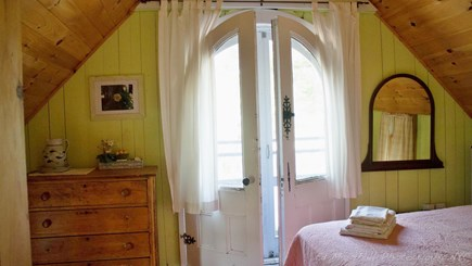 Oak Bluffs  Martha's Vineyard vacation rental - Charming front bedroom, vintage doors to balcony with (1)Queen
